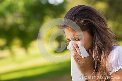 Woman Blowing Nose With Tissue Paper At Park Stock Photo ...