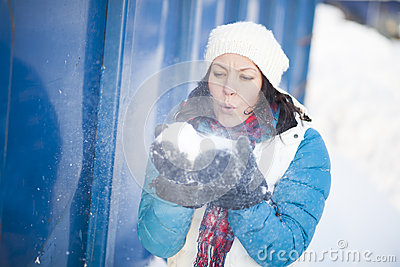 Woman blowing snow