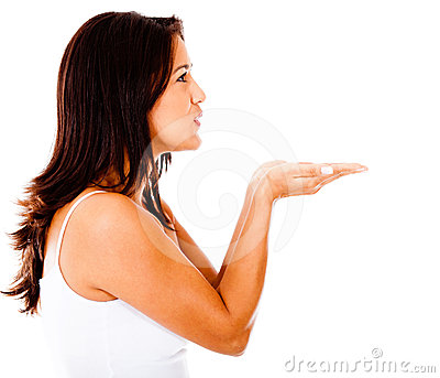 Woman blowing something