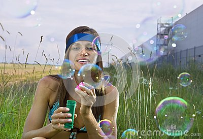 Woman blows soap bubbles