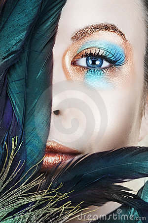 Woman with blue and bronze make-up