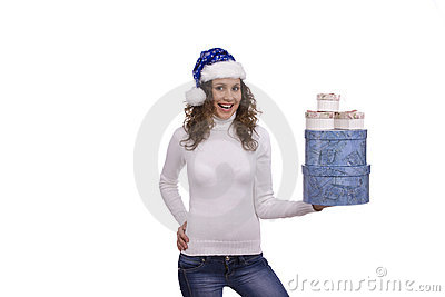 Woman in blue Christmas cap holding gift