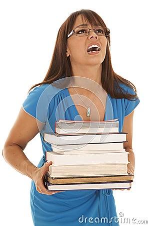 Woman in a blue dress books heavy