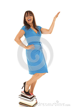 Woman in a blue dress books stand on