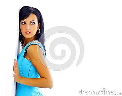 Woman in a blue dress posing