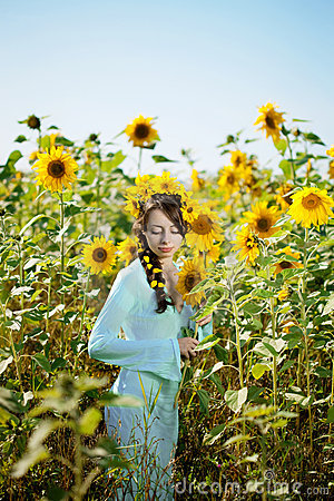 Woman with blue eyes with sunflowers