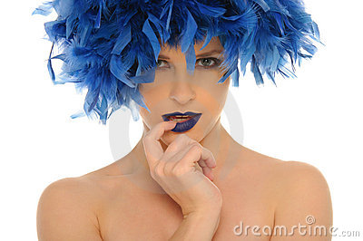 Woman in blue feathers with open eyes