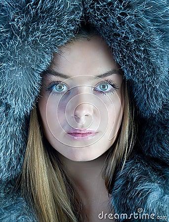 Woman in blue fur hat