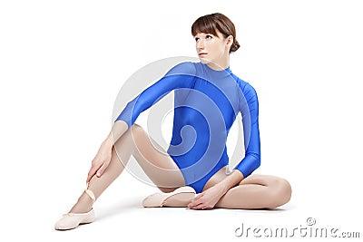Woman in blue gymnastic leotard