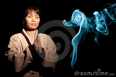 Woman and blue incense smoke.
