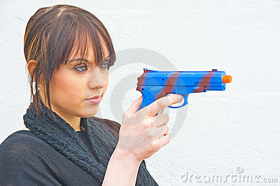 Woman with blue pistol.
