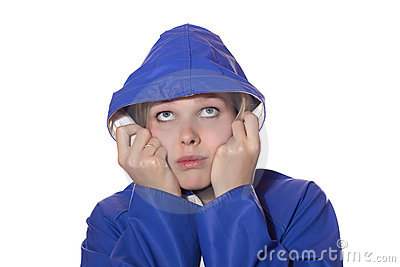 Woman in blue rain coat looking pessimistic