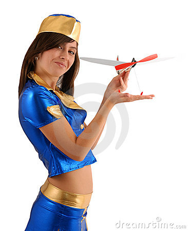 Woman in blue suit with small aircraft, sideview