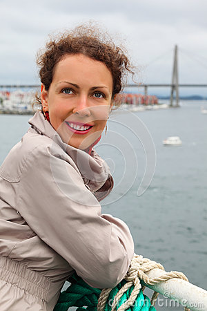 Woman is on board ship and smiles