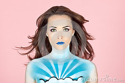 Woman with body painted to look like the sky