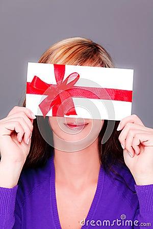 Woman with bonus coupon card gift