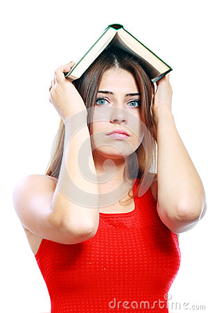Woman with book on her head