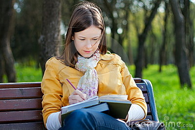 Woman with book in park
