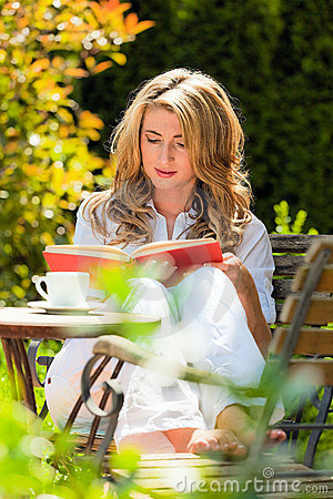 Woman at Book Reading in the Garden