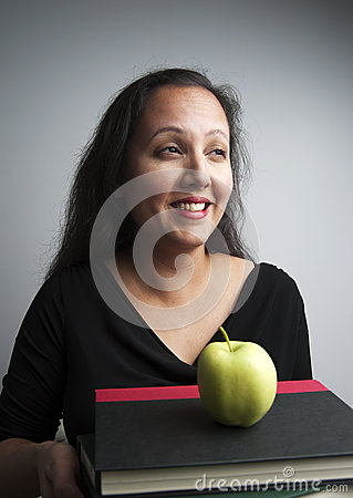 Woman with books and apple