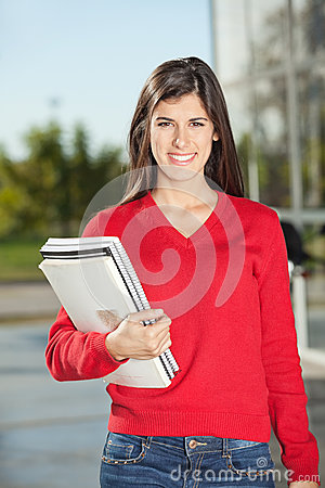 Woman With Books Standing On College Campus