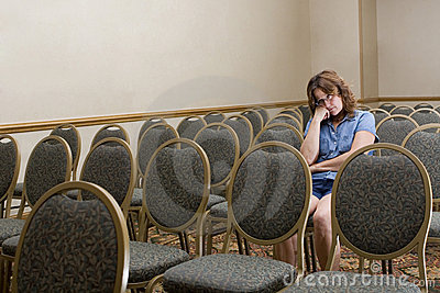 Woman at a boring conference