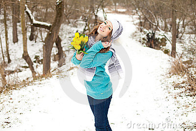 Woman with a bouquet of flowers at the park