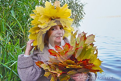 Woman with bouquet maple autumn leaves