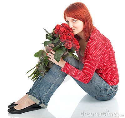 Woman with a bouquet of red roses