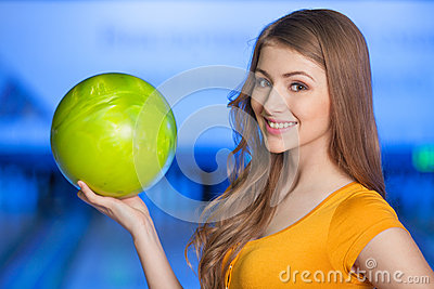 Woman in bowling alley.