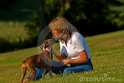Woman with boxer puppy dog