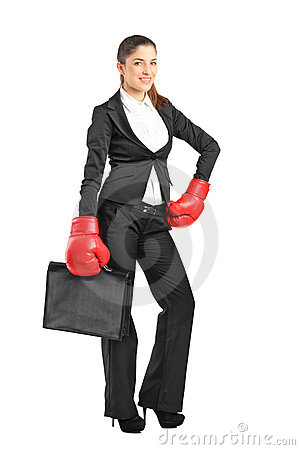Woman with boxing gloves holding a briefcase
