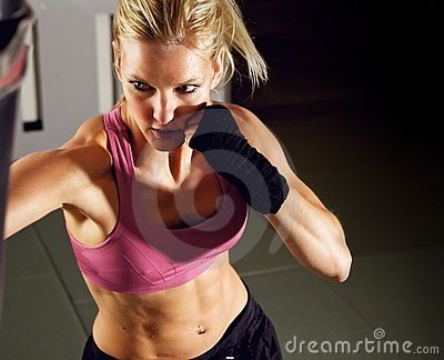 Woman Boxing in Gym