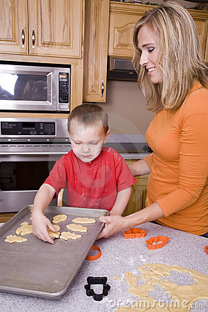 Woman and boy making Halloween cookies