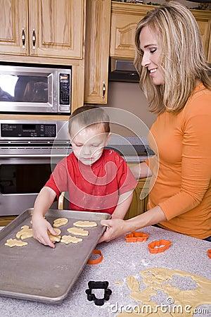 Woman and boy making Halloween cookies