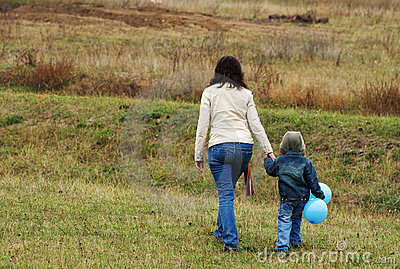 Woman and boy on the meadow