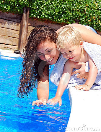 Woman and boy by the pool side