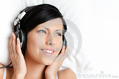 Woman in bra listens to music