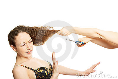 Woman in bra resists funny hairstyle