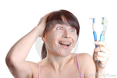 Woman with braces with toothbrushes