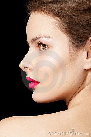 Woman with bright fuchsia lips make-up, clean skin