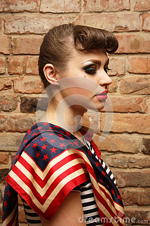 Woman with bright makeup on brick background