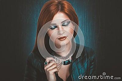 Woman with bright orange hair Stock Photo