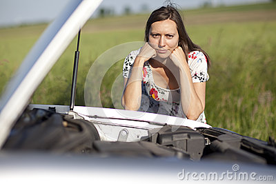 Woman and broken car
