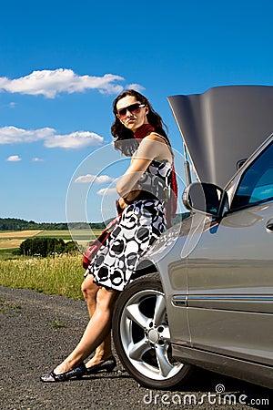 Woman by broken down car