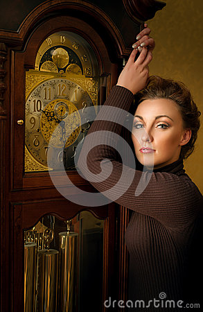 Woman and antique clock