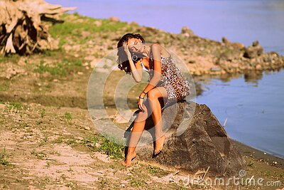 Woman In Brown And Black Leopard Cami Dress Siting On Grey Rock During Daytime Free Public Domain Cc0 Image