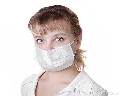 Woman with brown hair and a medical mask