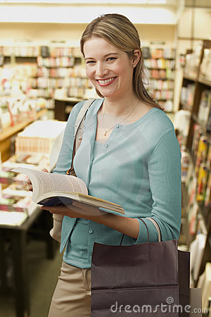 Woman Browses in a Bookstore