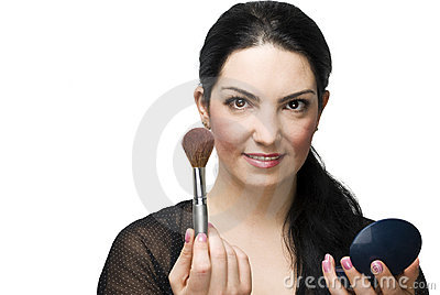 Woman with brush for blush and mirror
